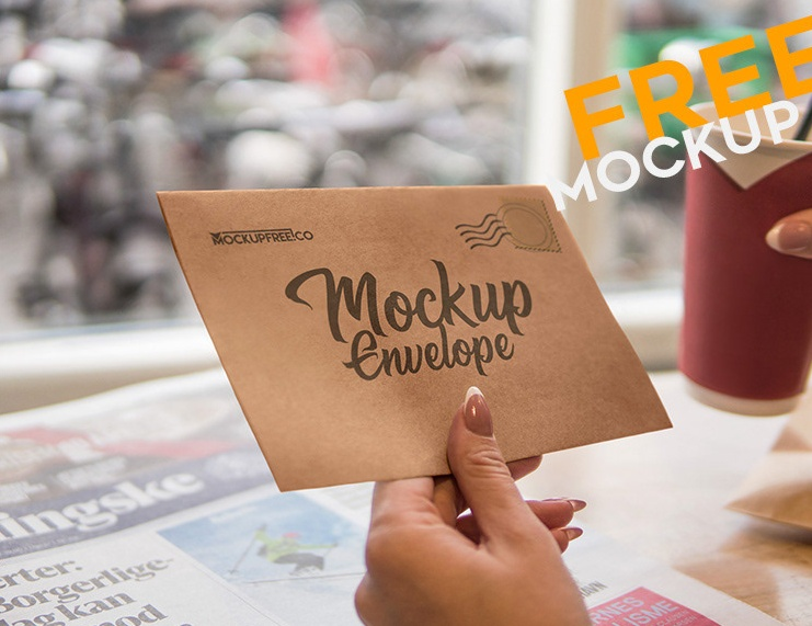 Envelope in Hand Mockup PSD