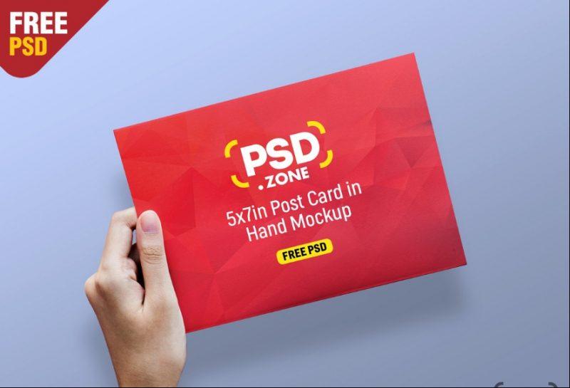 Postcard in Hand Mockup PSD